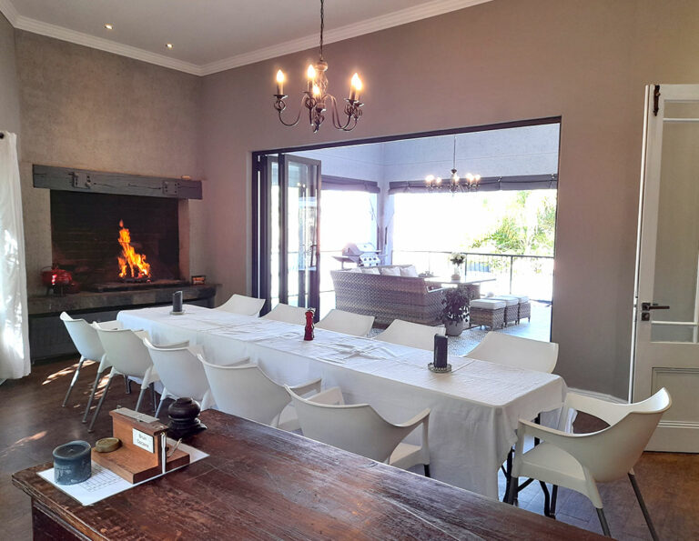 Bar area with fireplace leading to covered patio at Safari Villa.