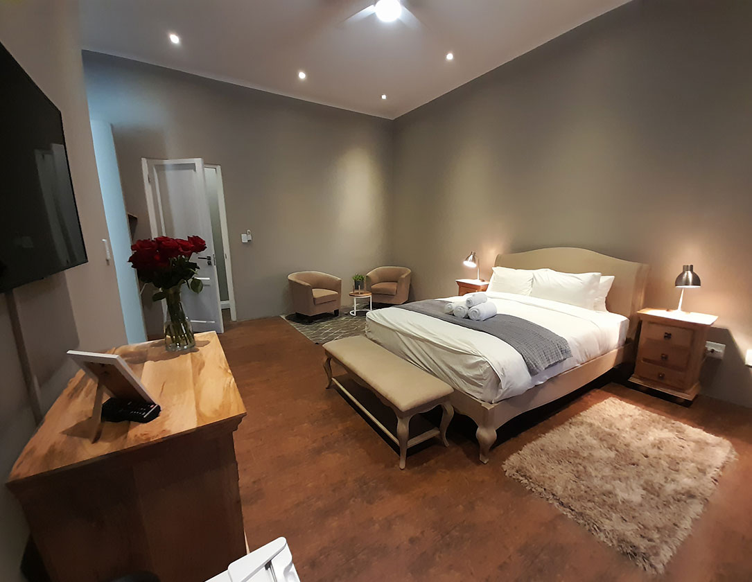 Suite 1 Safari Villa rental with queen-size bed with a sofa bed & sitting area. Ensuite & dressing room. Windhoek, Namibia